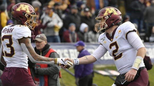 Minnesota receiver Rashod Bateman celebrates with QB Tanner Morgan