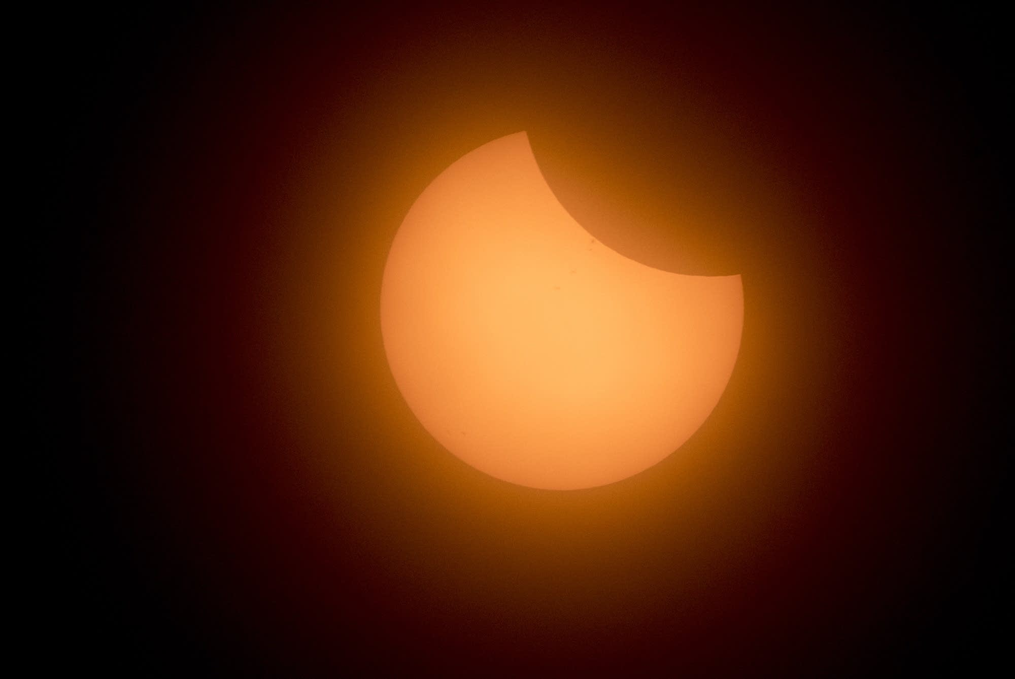 The clouds cleared in time for the beginning of the total solar eclipse.