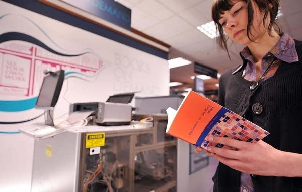 A member of staff reads a test book prin