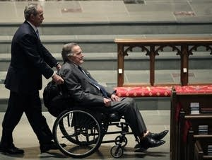 Former Presidents George W. Bush, left, and George H.W. Bush.