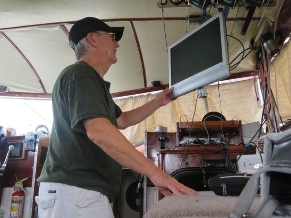 Ken Merryman of Fridley, Minn., inside the cabin of his boat