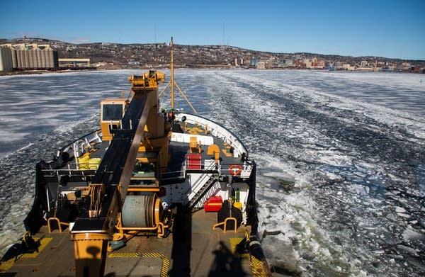 The U.S. Coast Guard Cutter Alder breaks ice to create navigation lanes.