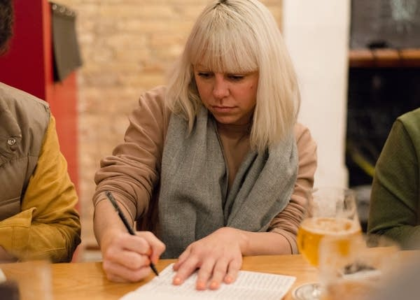 Bobbi Barron practices writing in cursive during a meet-up.