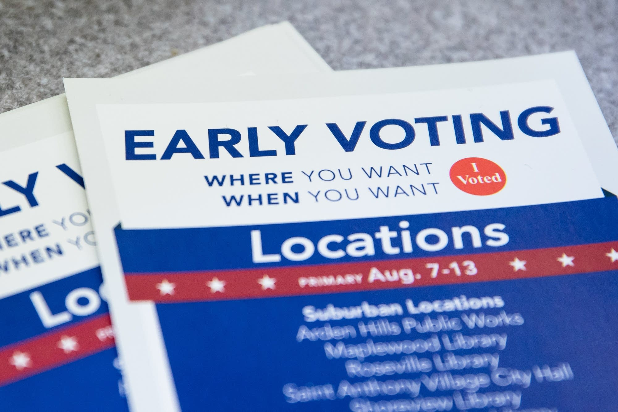 An early voting pamphlet sits on a table.