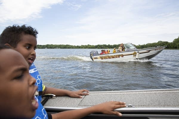 Cmdr. Eric Bradt takes campers out for boat rides on Lake Andrew.