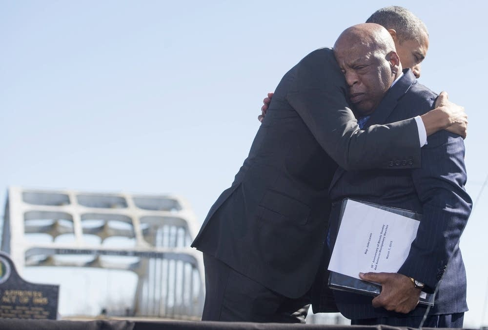 President Obama hugs Rep. John Lewis, right.