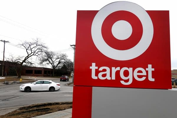 A car drives by a Target sign.