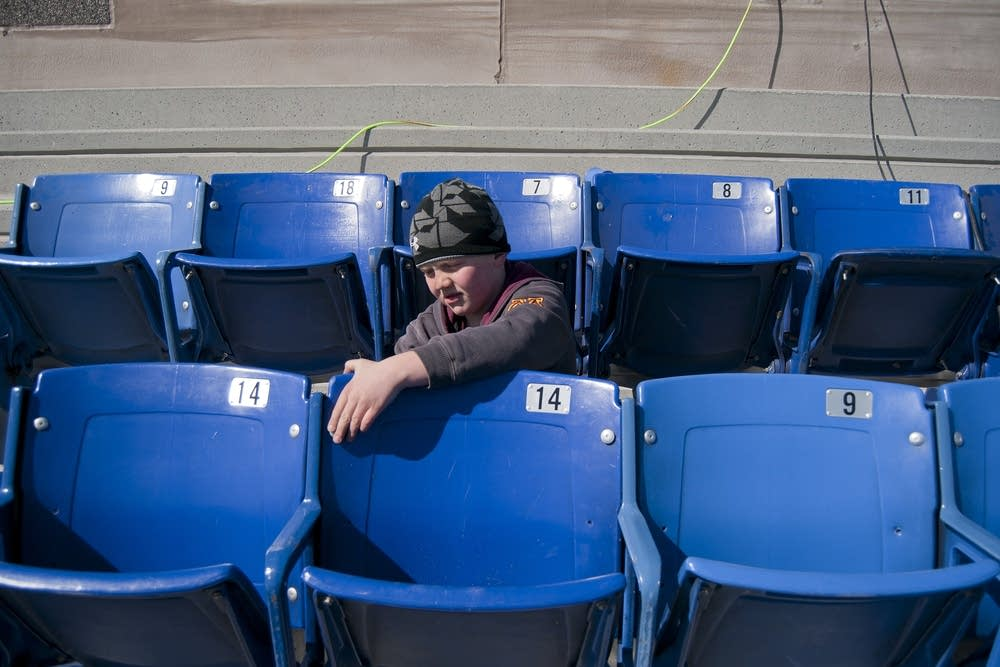 Blake Bullerman, 8, tightens a bolt on a seat back