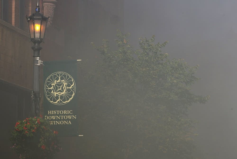 Smoke shrouds the streets of Winona.