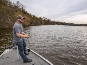 Devin Koob of Sauk Rapids fishes on the Mississippi