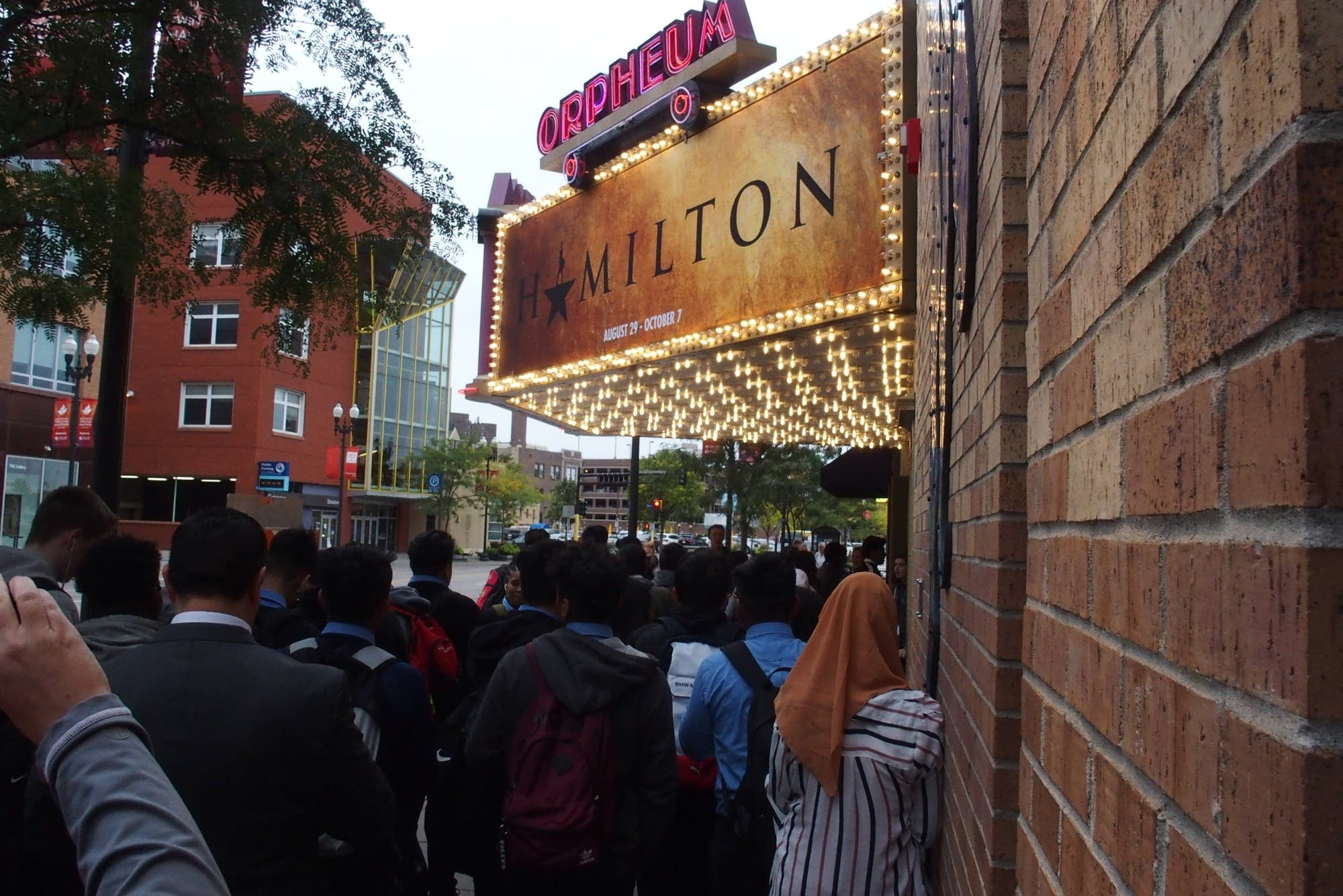 Students walk towards the entrance of the Orpheum Theatre in Minneapolis