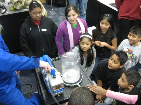 Students watch a science experiment