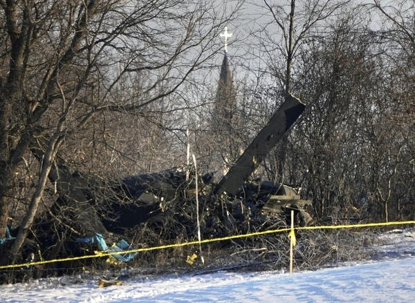 The remains of a crashed helicopter in the trees