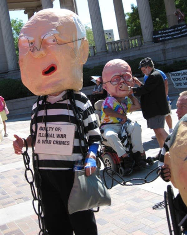 Protesters mock Dick Cheny and George Bush