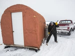 John Odle, Jr., preps ice houses.