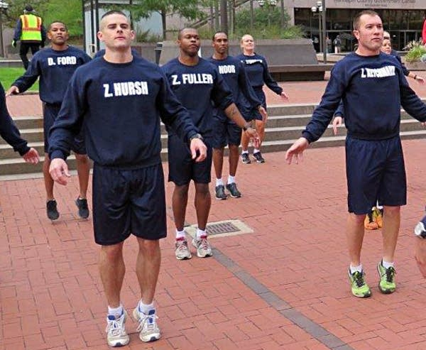 Mohamed Noor, center rear, was among cadets working out in 2015.