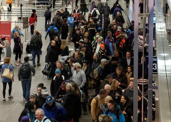 Long lines form at Minneapolis-St. Paul International Airport.