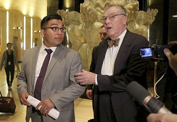 Jeronimo Yanez and attorney Tom Kelly leave the Ramsey Co. Courthouse.