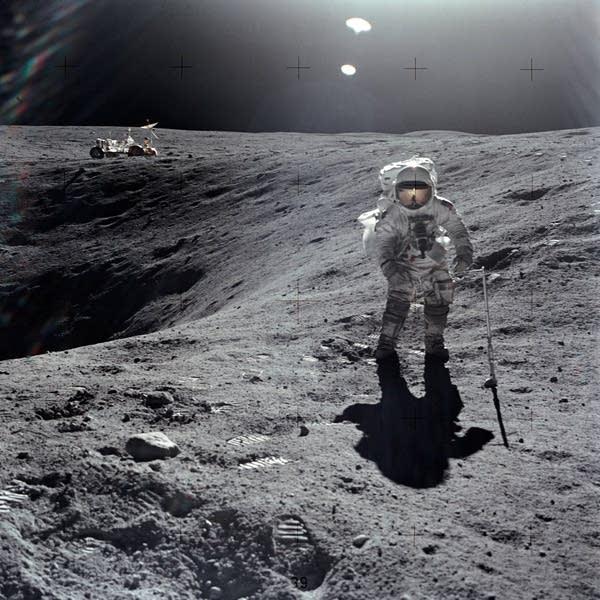 Astronaut Charles M. Duke Jr. collecting lunar samples