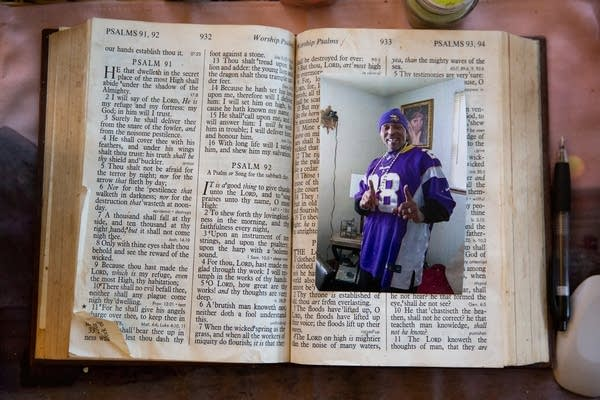 A photo of a man in a jersey inside a bible.