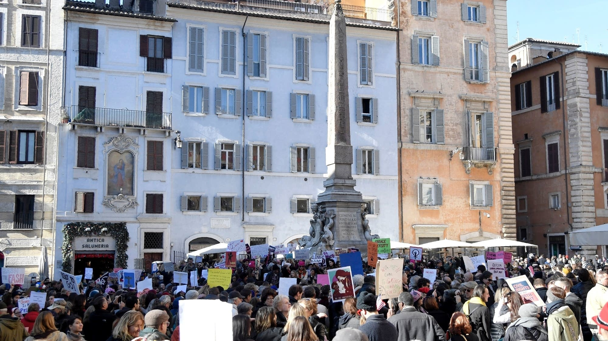 Rome, Italy: People shout and hold signs during a rally.