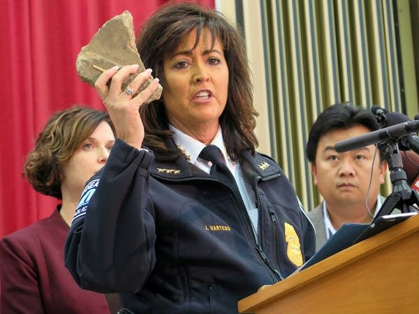 Chief Harteau shows a rock thrown at a squad car.