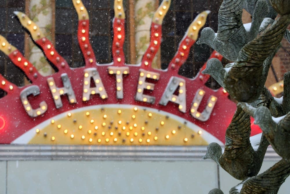 Snow falls in front of the Chateau Theater