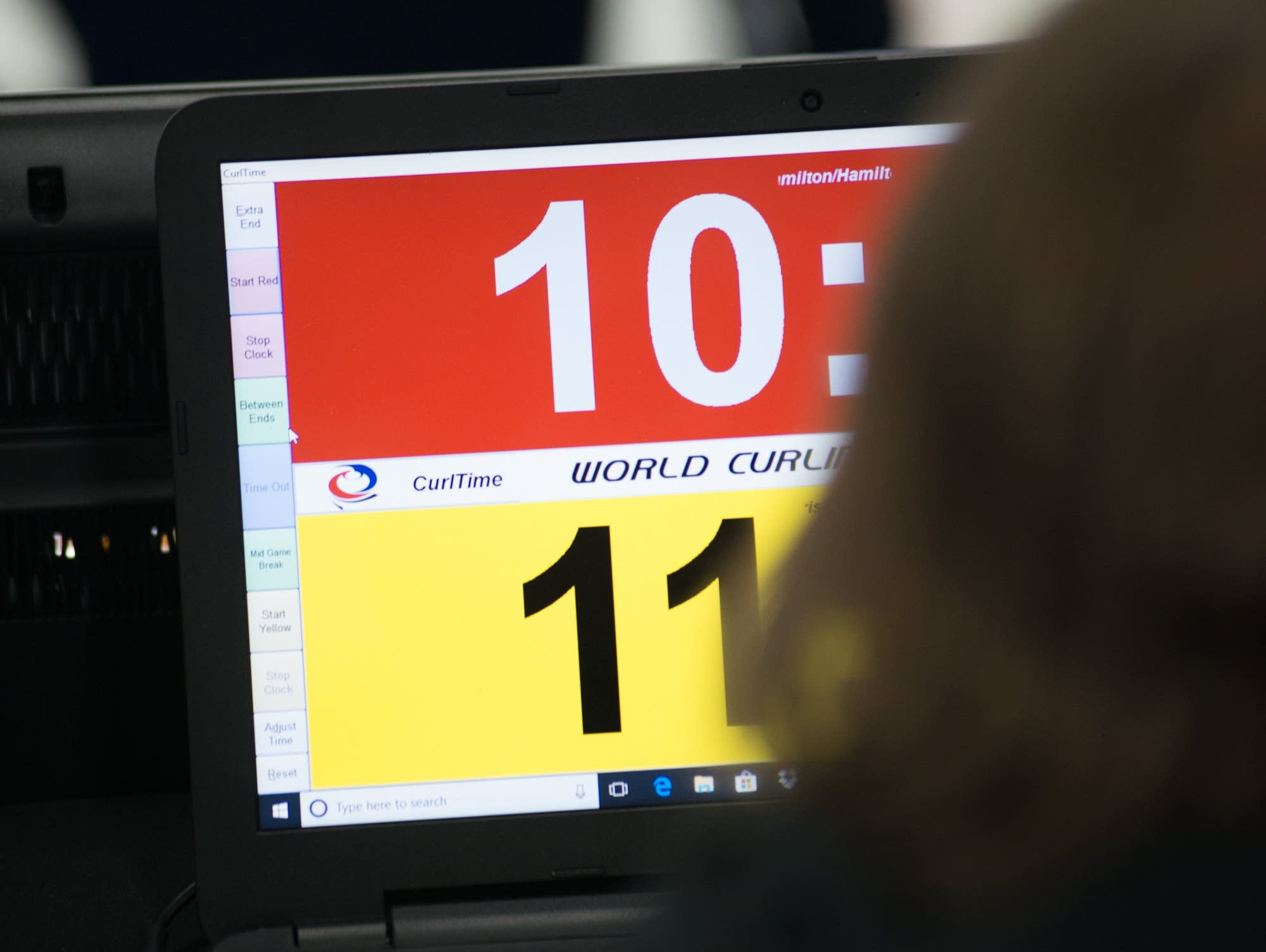 An official keeps time during the 2018 U.S. Olympic Team Trials Final.