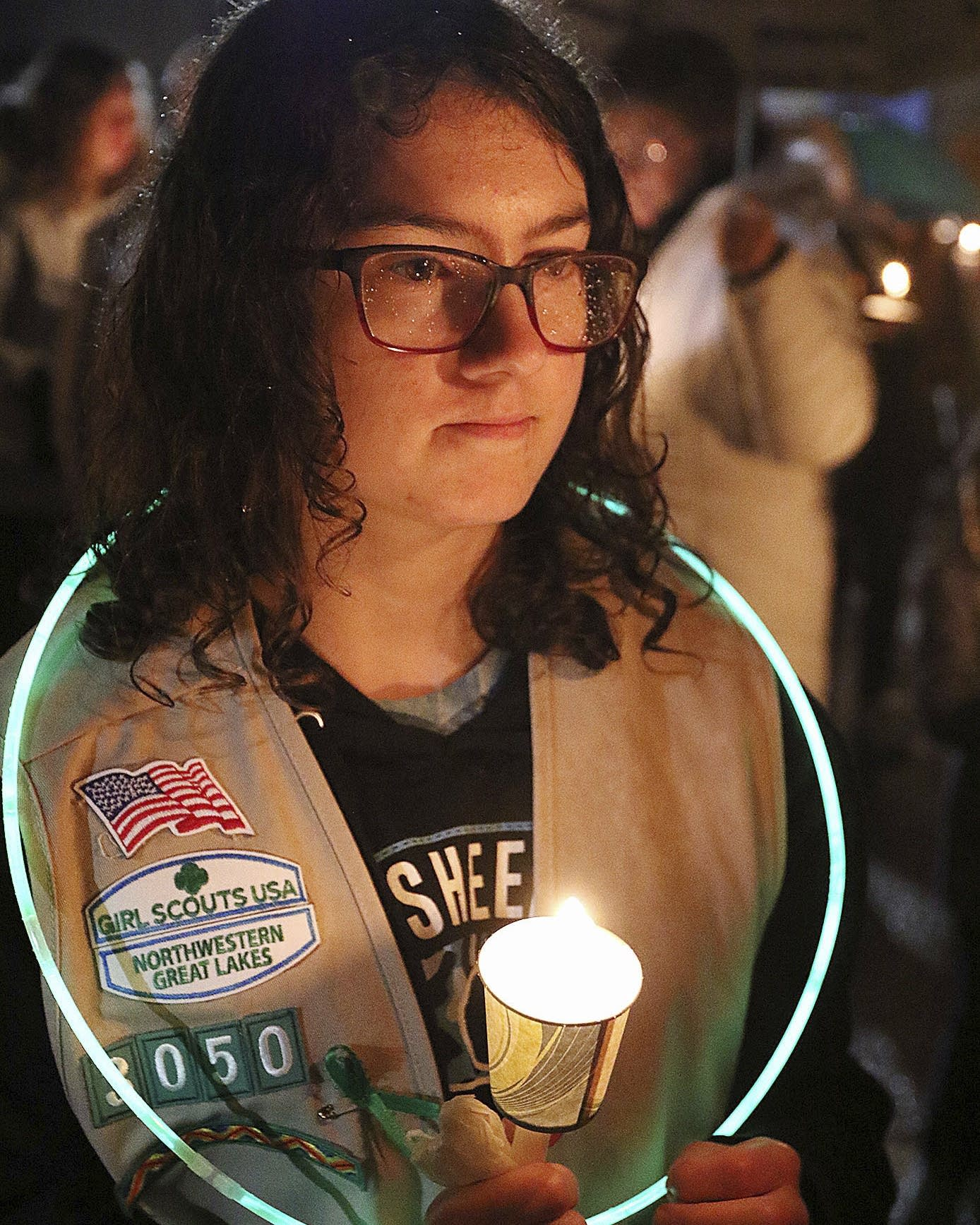 Girl Scout Jessica Lauterbach, 12, attends the candlelight vigil