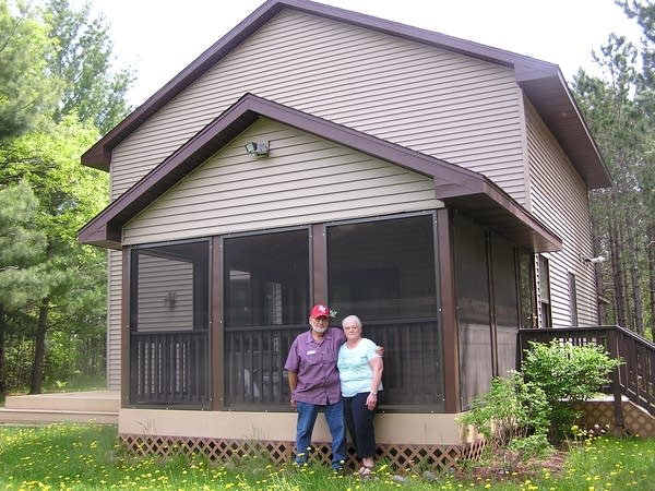 Bill and Shirley Klossner stand outside their home