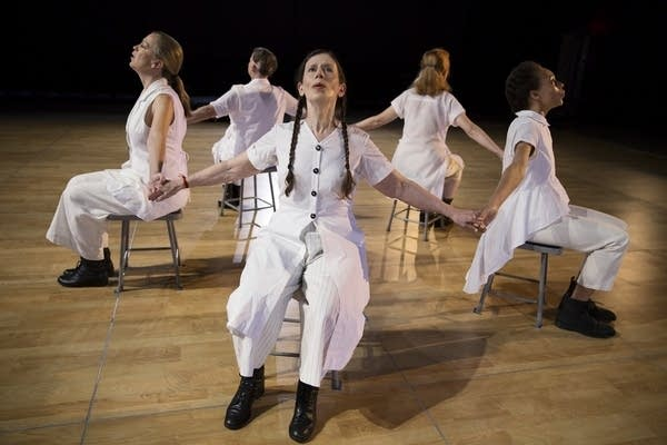 Meredith Monk and a group of her dancers in a circle