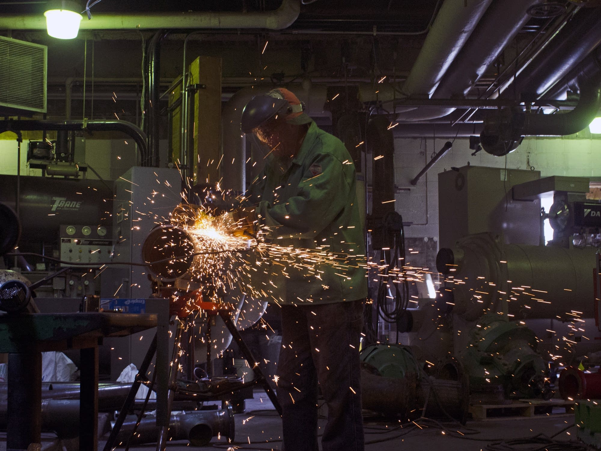 Jay Larson welds in the U.S. Bank boiler room.