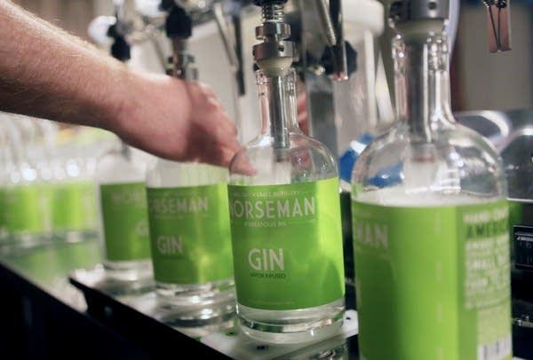 Filling bottles at Norseman Distillery