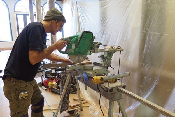 Cutting a piece of wood