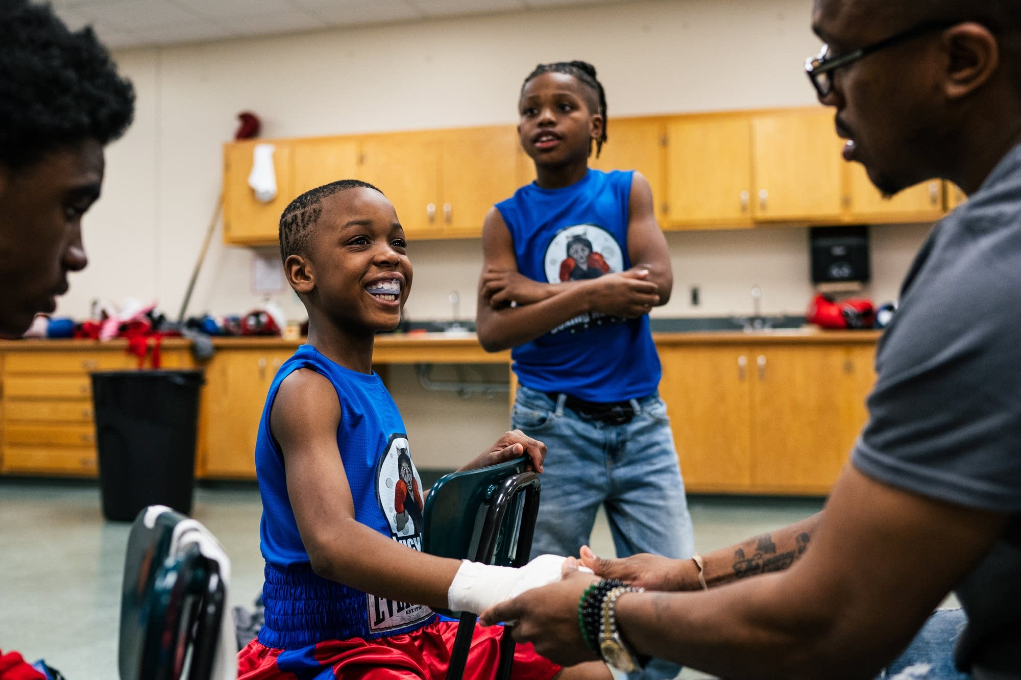 Eight-year-old Z'Karion Walker gets his hands wrapped.