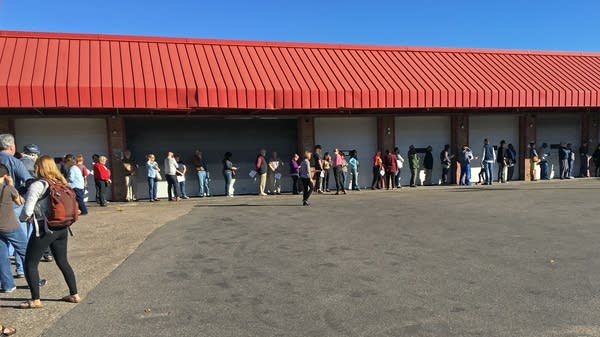 About 70 people waited in line at an early voting center.