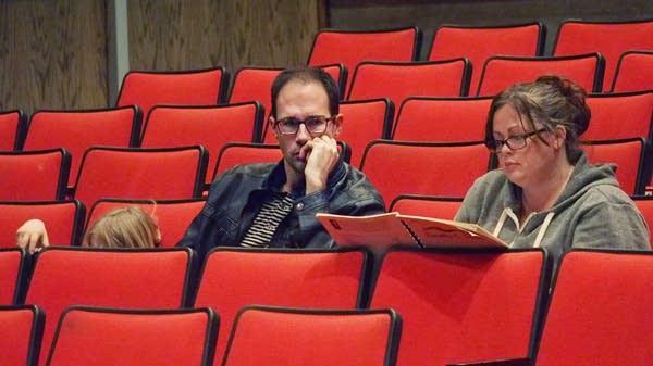 Composer Tim Takach and spoken word artist Desdamona listen.