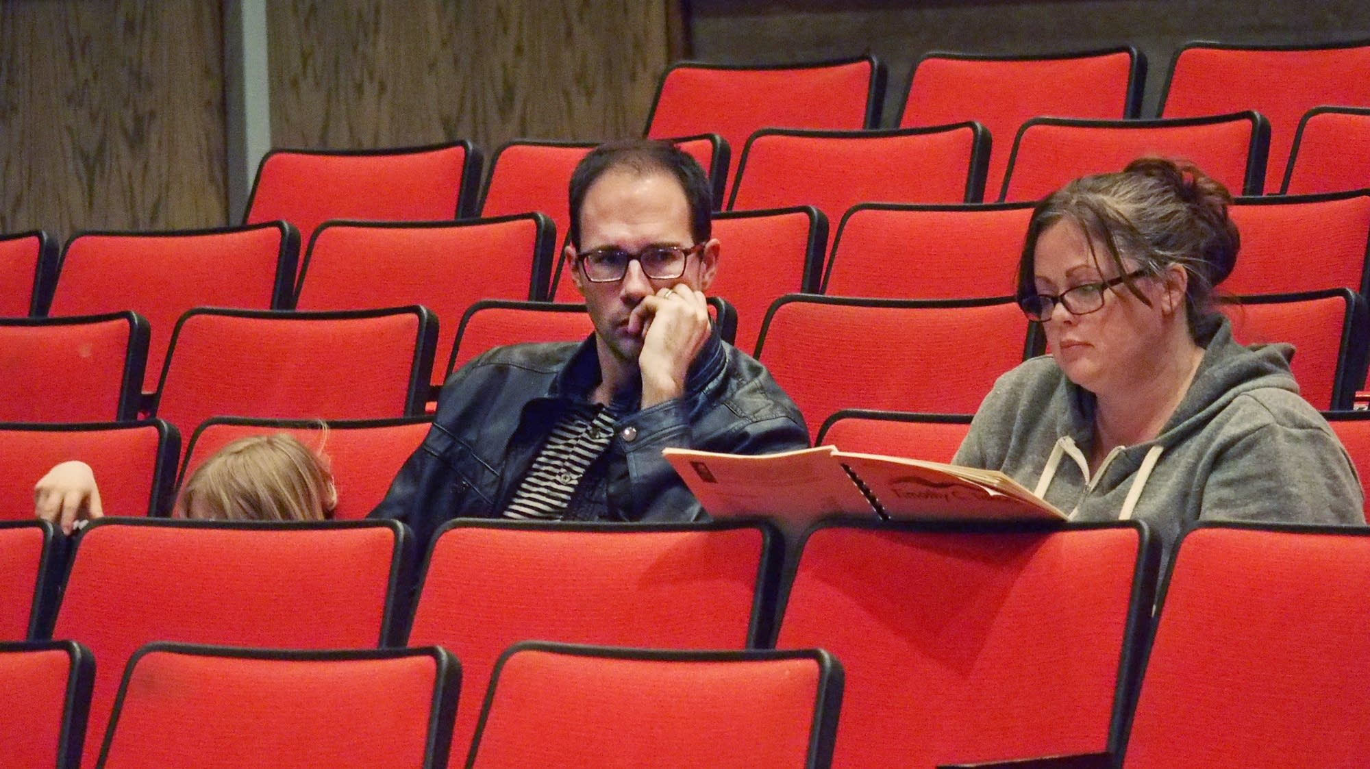 Composer Tim Takach and spoken word artist Desdamona listen.