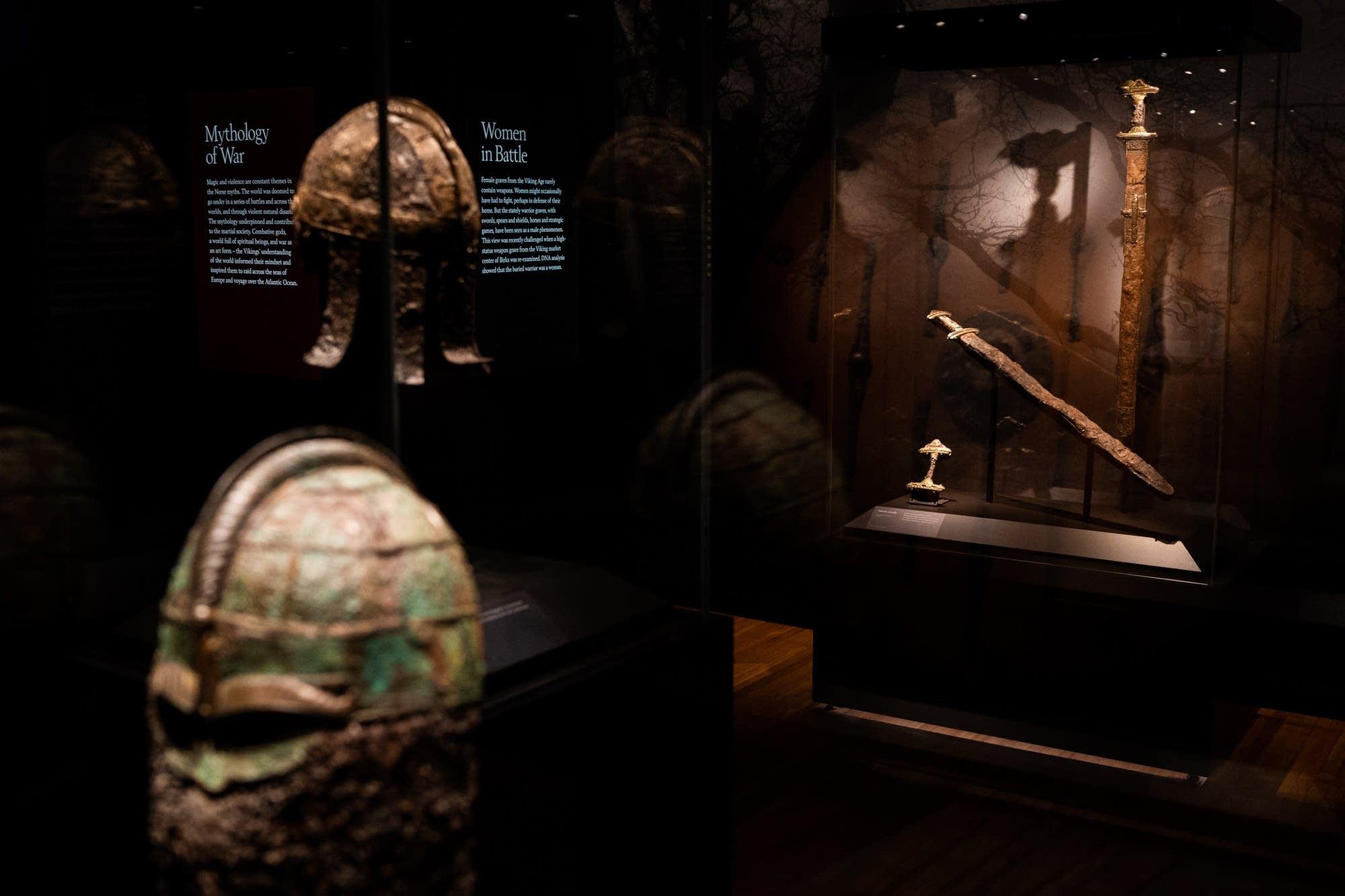 Viking helmets and swords sit on display.