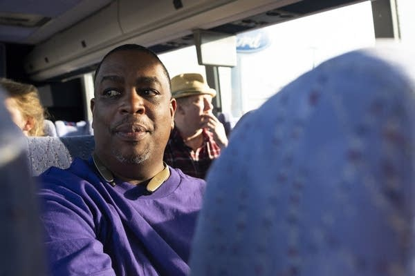 Carl Crawford looks out the window of a the coach bus after a night's ride.