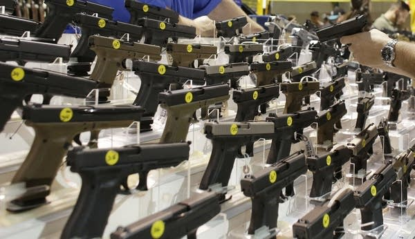 Pistol display at a gun show