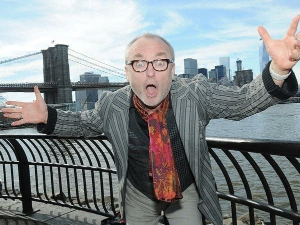 Composer Jacob TV strikes an animated pose in from of the New York skyline.