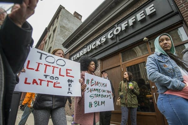 Protesters gather outside of a Starbucks in Philadelphia/