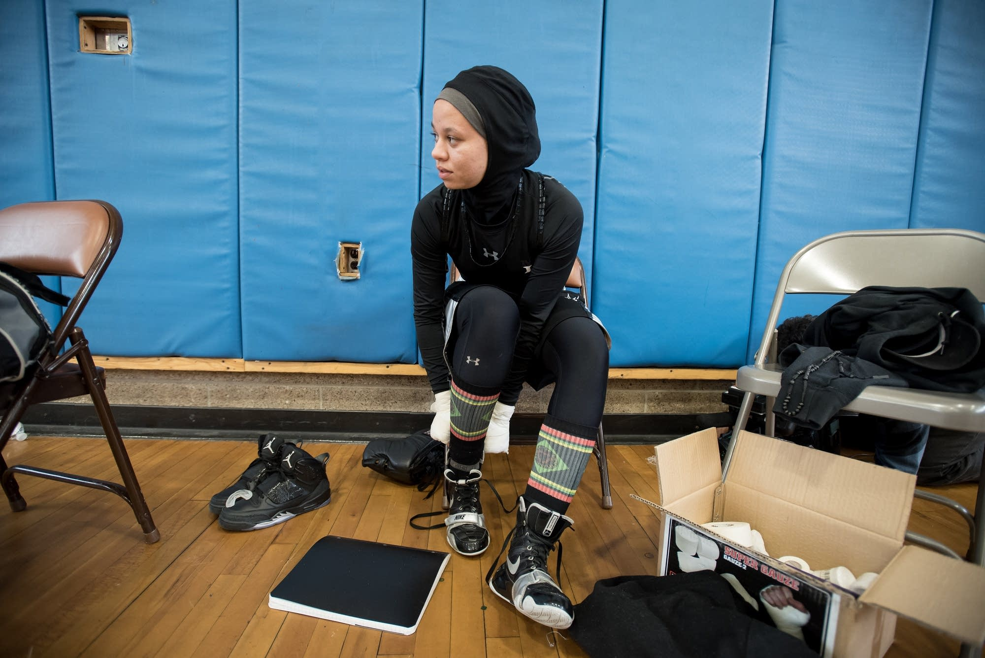Amaiya Zafar, 16, of Oakdale, changed  into her boxing shoes.