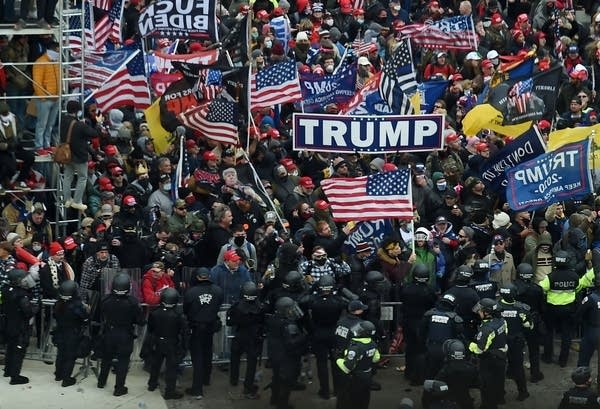Police hold back Trump supporters