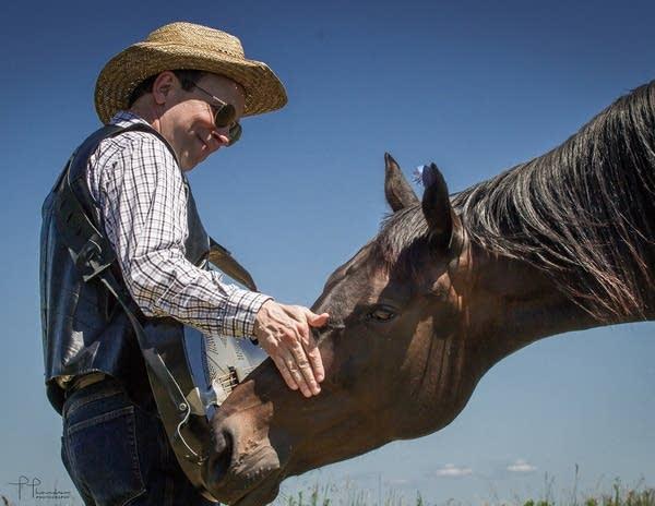 AJ Scheiber greets a horse