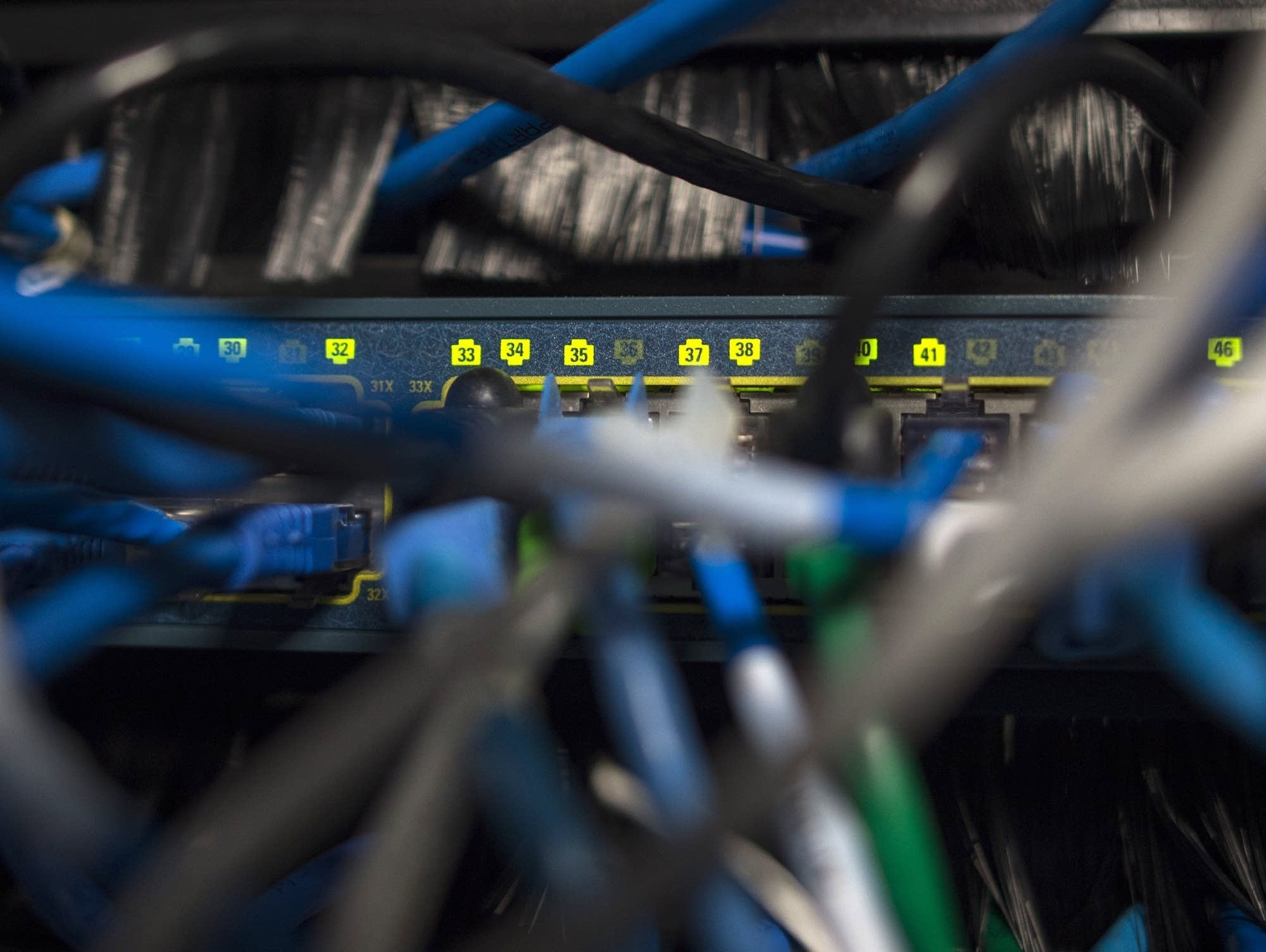 Network cables are seen going into a server in an office building.