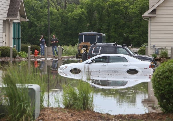 A car is submerged in flood water in the the Zumbro Valley Health Center.