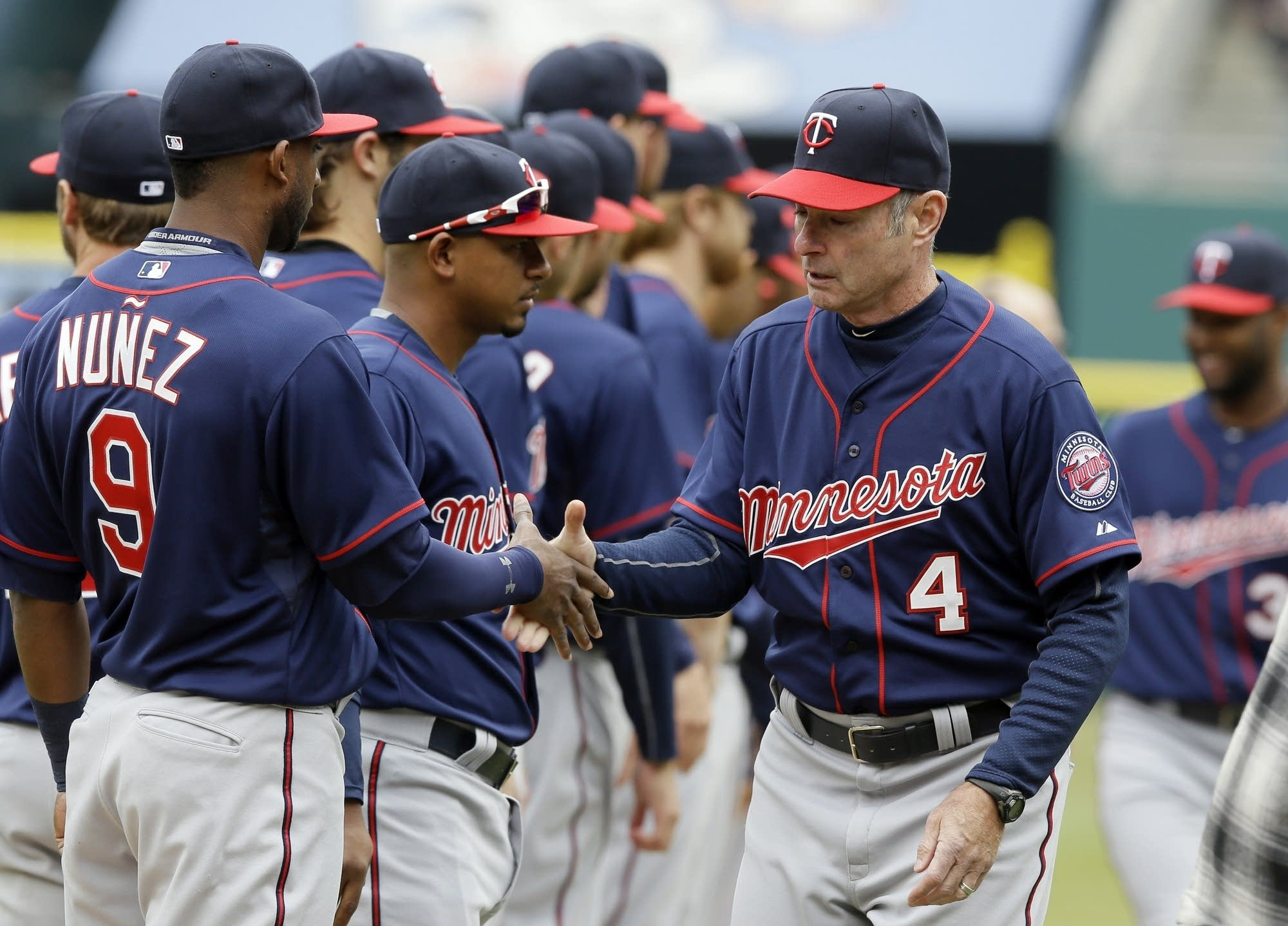 Twins manager Paul Molitor greets players baseball