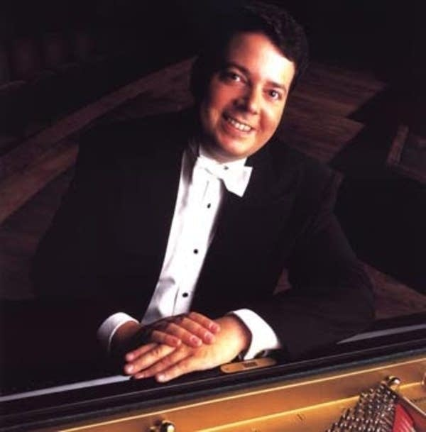 Litton conducts and plays piano